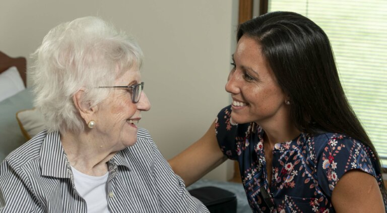 Nurse at health care center visiting a resident