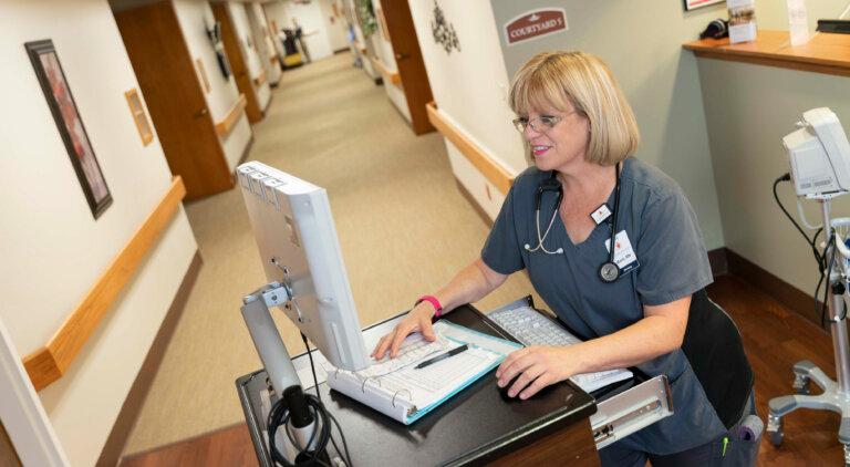 Nurse enter information into a computer