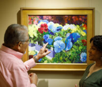 Two residents admiring the art gallery