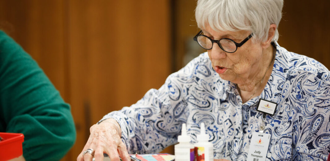 A resident doing an arts and crafts class