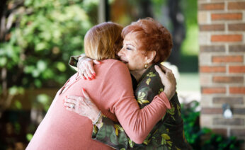 Two people embrace in a hug