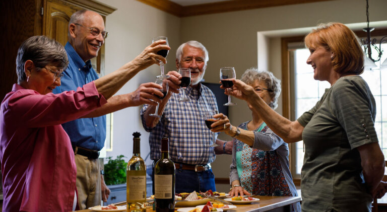 Group of residents enjoying a glass of wine