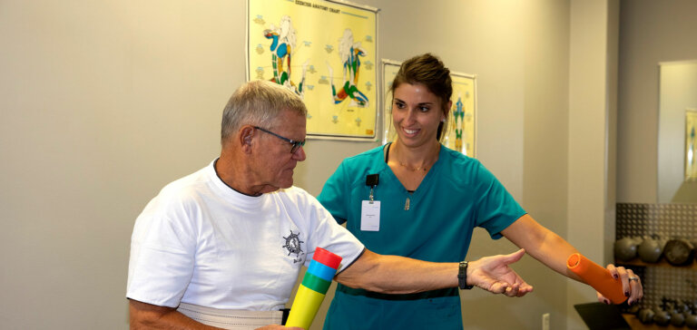Nurse providing rehab services in transitional care