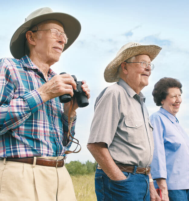 Retired Residents Enjoying A View On A Hike Outdoors